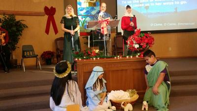 From left to right Tammi Fay, Garrison, Sandy, Candy, Sarah, baby Jesus and Raphael. Singing O Come O Come, Immanuel!!